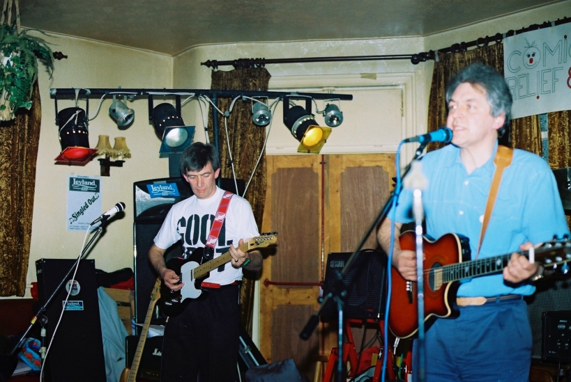 Band with no name i.e. Barrie & Mike performing at Red Nose Day gig in 1989 with Barrie on guitar
