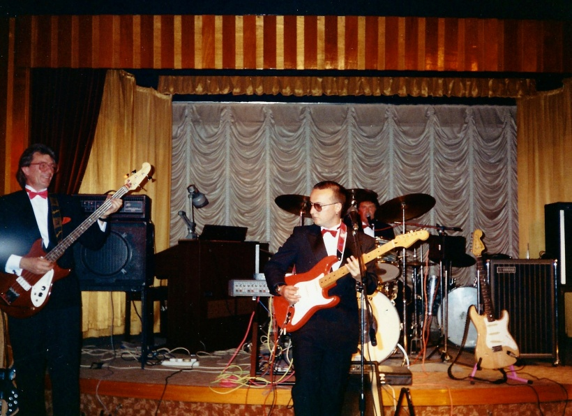 Mike playing bass guitar for a change with Oh Boy covers band c 1990